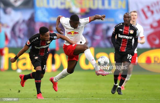 Wendell of Bayer 04 Leverkusen battles for possession with Nordi Mukiele of RB Leipzig during the Bundesliga match between RB Leipzig and Bayer 04...