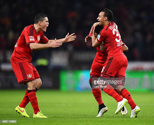 Wendell of Bayer 04 Leverkusen is congratulated by Kyriakos Papadopoulos and Karim Bellarbi after scoring the first goal during the Bundesliga match...