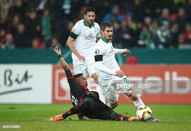 Wendell of Bayer Leverkusen fouls Fin Bartels of Werder Bremen for a penalty and is sent off during the DFB Cup Quarter Final match between Bayer...