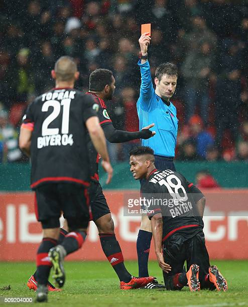 Wendell of Bayer Leverkusen is shown a red card and is sent off by referee Wolfgang Stark during the DFB Cup Quarter Final match between Bayer...