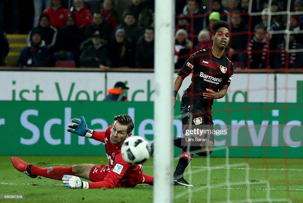 Wendell of Bayer Leverkusen scores his teams first goal against Thomas Kessler of Koeln during the Bundesliga match between 1. FC Koeln and Bayer 04 Leverkusen at RheinEnergieStadion on December 21, 2016 in Cologne, Germany.