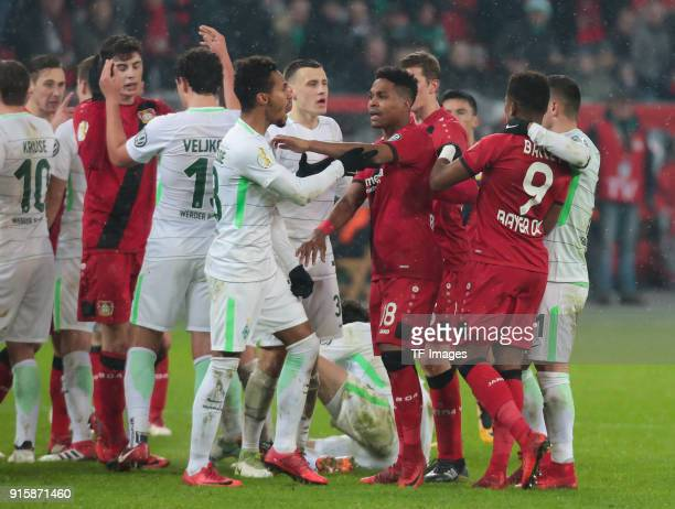 Wendell of Leverkusen and Theodor Gebre Selassie of Bremen stand togheter during the DFB Cup match between Bayer Leverkusen and Werder Bremen at...