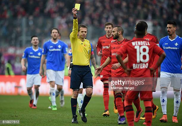 Wendell of Leverkusen is shown an yellow card by referee Dr Jochen Drees during the match between SV Darmstadt 98 and Bayer Leverkusen at...