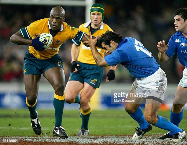 Wendell Sailor for the Wallabies fends off Carlos Nieto for Italy during the Bundaberg Rum International Rugby Test Match between Australia and Italy...