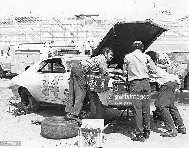 Wendell Scott and his crew work on their Ford in the pits at the Alabama International Motor Speedway, circa 1971.