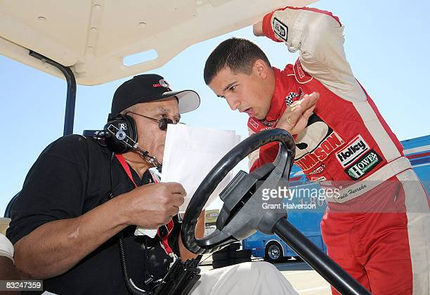 Wendell Scott confers with Paul Harraka during the NASCAR Drive for Diversity Combine at South Boston Speedway on October 13, 2008 in South Boston,...