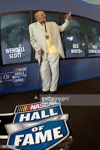 Wendell Scott, Jr., takes a self-portrait with a photo of his father, NASCAR driver Wendell Scott, after the announcement of the 2015 NASCAR Hall of...