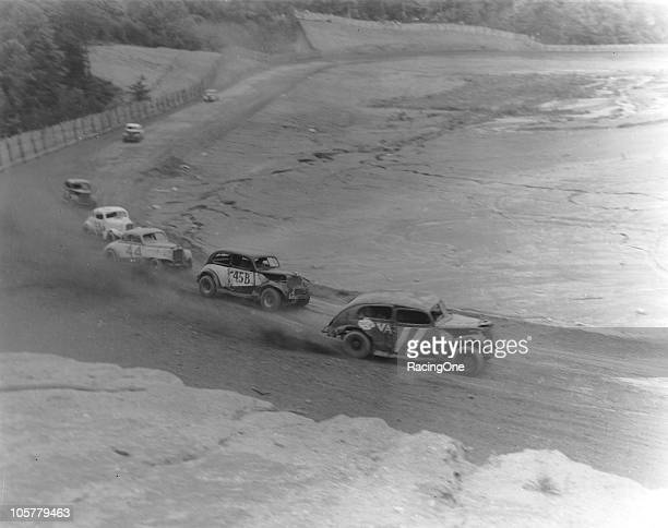 Wendell Scott leads a pack of Modified stock cars during a race at a Virginia dirt track.