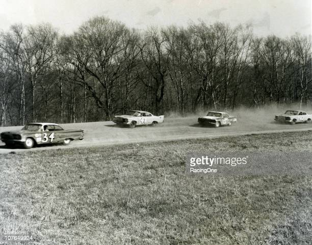 Wendell Scott leads Maurice Petty , Rex White and Richard Petty during a NASCAR Cup race at Orange Speedway.