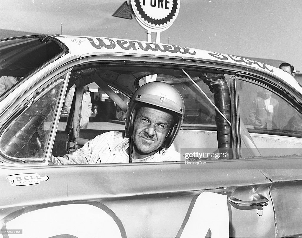 Wendell Scott poses for a portrait in his car as he became the first African-American driver to win in the NASCAR Cup division with a victory in 1963 at Jacksonville Speedway Park in Jacksonville, Florida. Scott was NASCAR's first black competitor, starting in the sportsman class in 1953.