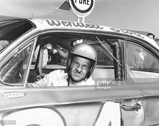 Wendell Scott poses for a portrait in his car as he became the first AfricanAmerican driver to win in the NASCAR Cup division with a victory in 1963...