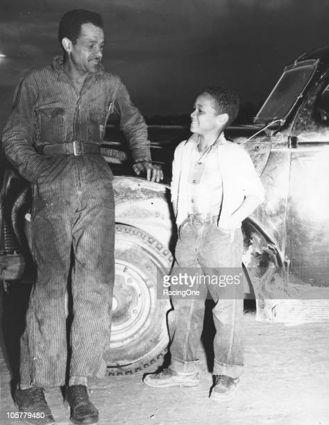 Wendell Scott poses with his young son at a Modified race.