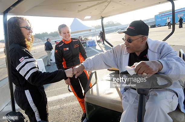 Wendell Scott, right, greets drivers Megan Reitenour, left, and Trista Stevenson during the NASCAR Drive for Diversity Combine at South Boston...