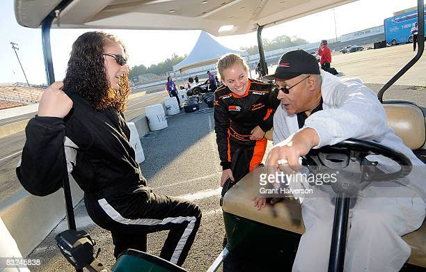 Wendell Scott, right, offers driving tips to Megan Reitenour, left, and Trista Stevenson during the NASCAR Drive for Diversity Combine at South...