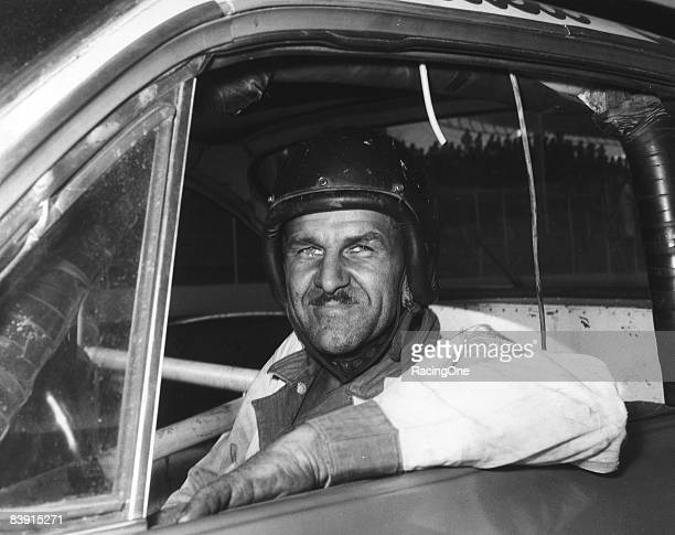 Wendell Scott sits in his car before a race at the Martinsville Speedway circa 1963 in Martinsville, Virginia.