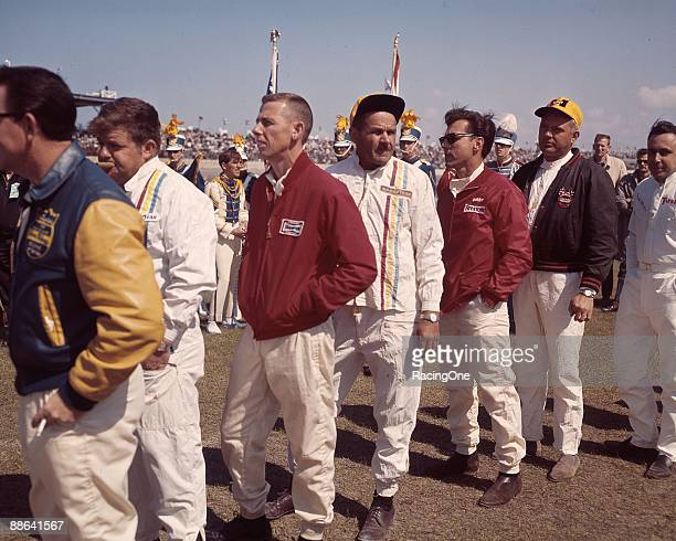 Wendell Scott stands ahead of Bobby Johns in a driver's line.