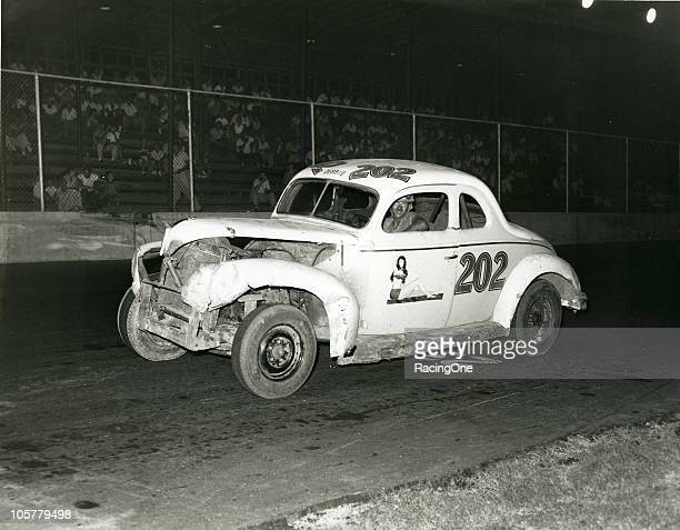 Wendell Scott, who would go on to a career on the NASCAR Cup circuit beginning in 1961, at the wheel of one of his Modified cars.