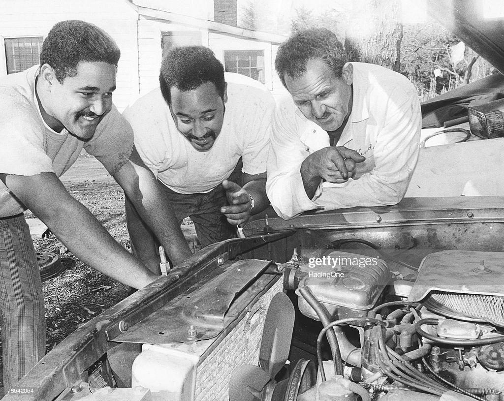 Wendell Scott and Sons Work on Engine : News Photo
