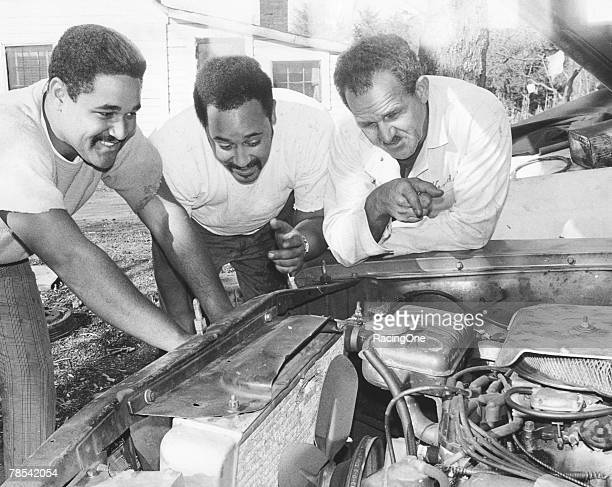 Wendell Scott with sons Wendell Jr. And Frankie work on enging in Danville, Virginia.