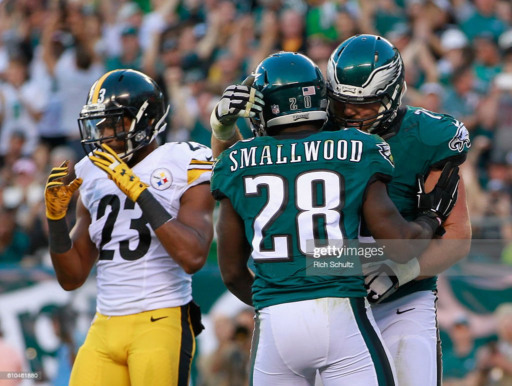 Wendell Smallwood #28 of the Philadelphia Eagles celebrates his rushing-touchdown with teammate Allen Barbre #76 as Mike Mitchell #23 of the Pittsburgh Steelers looks on in the third quarter at Lincoln Financial Field on September 25, 2016 in Philadelphia, Pennsylvania.
