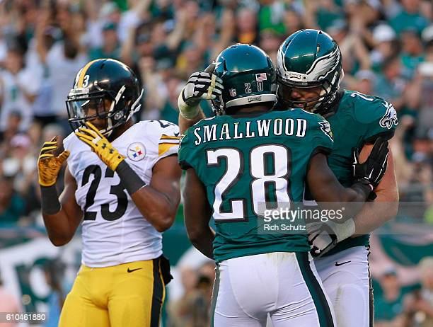 Wendell Smallwood of the Philadelphia Eagles celebrates his rushing-touchdown with teammate Allen Barbre as Mike Mitchell of the Pittsburgh Steelers...