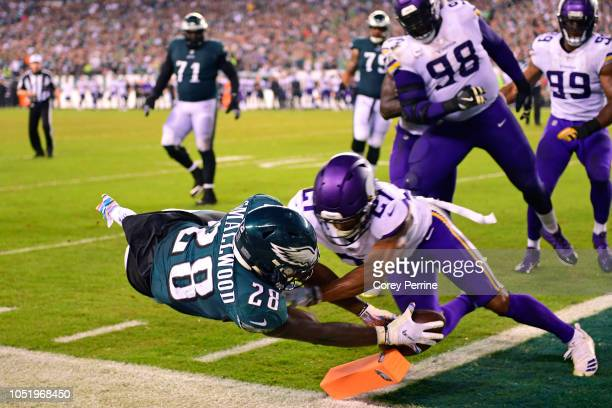 Wendell Smallwood of the Philadelphia Eagles scores a two point conversion against Mike Hughes of the Minnesota Vikings during the fourth quarter at...
