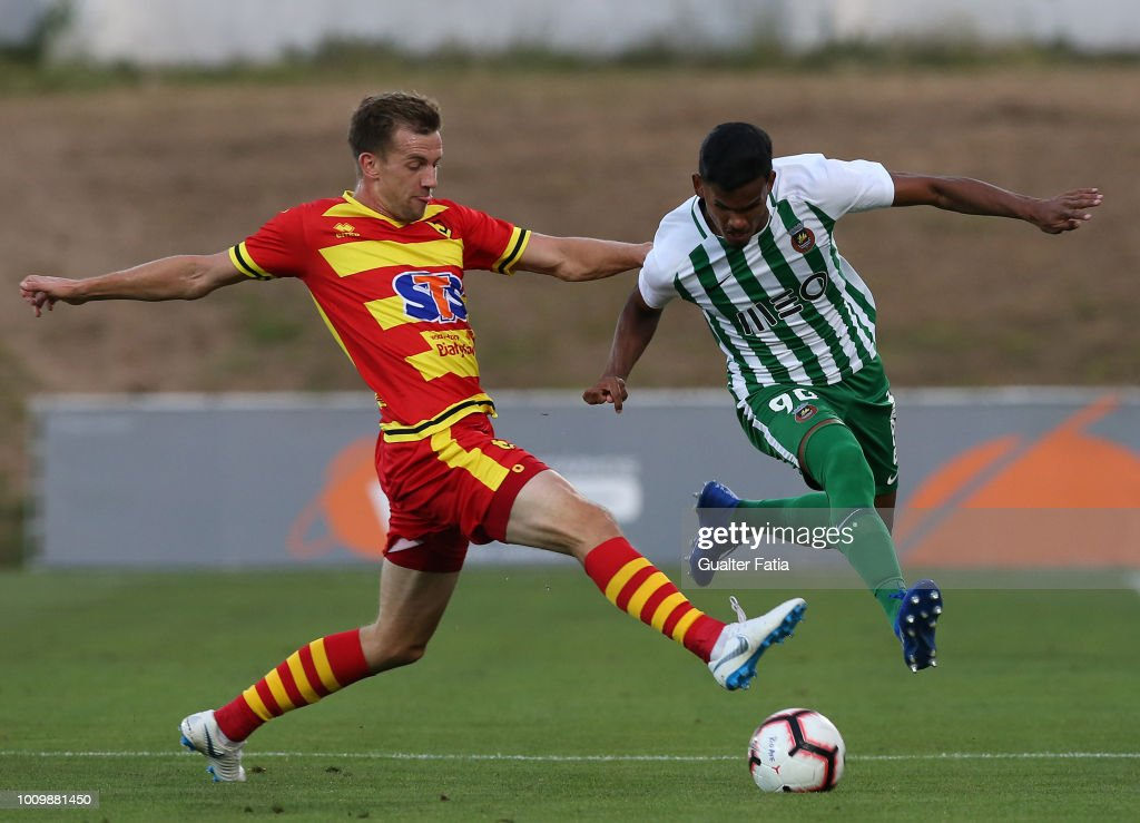 Wenderson Galeno of Rio Ave FC competes for the ball with Bartosz Kwiecien of Jagiellonia during the UEFA Europa League Second Qualifying Round 2nd Leg match between Rio Ave FC and Jagiellonia at Estadio dos Arcos on August 2, 2018 in Vila do Conde, Portugal.