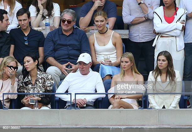 Wendi Deng David Geffen Ivanka Trump Dasha Zhukova above Karlie Kloss attend the men's final between Novack Djokovic of Serbia and Stan Wawrinka of...