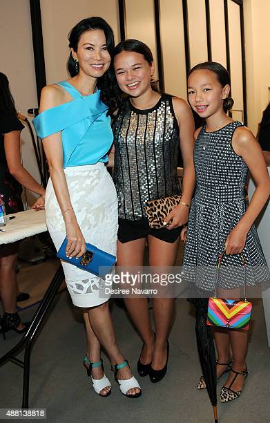 Wendi Deng Murdoch poses with her children Grace Helen Murdoch and Chloe Murdoch backstage during Diane Von Furstenberg Spring 2016 New York Fashion...