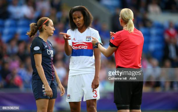 Wendi Renard of Olympique Lyonnais points the finger at Sabrina Delannoy of PSG as Referee Bibiana Steinhaus speaks to them both during the UEFA...