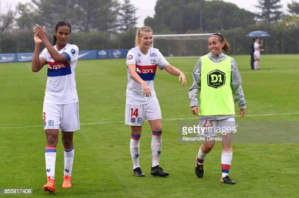 Wendie Renard Ada Hegerberg and Camille Abily celebrate the Victory during the women's Division 1 match between Montpellier and Lyon on September 30...