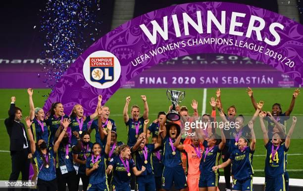 Wendie Renard captain of Olympique Lyon lifts the UEFA Women's Champions League Trophy following her team's victory in the UEFA Women's Champions...