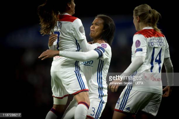 Wendie Renard celebrates with team mate Saki Kumagai and Ada Hegerberg after scoring her team's 2nd goal during the UEFA Women's Champions League...