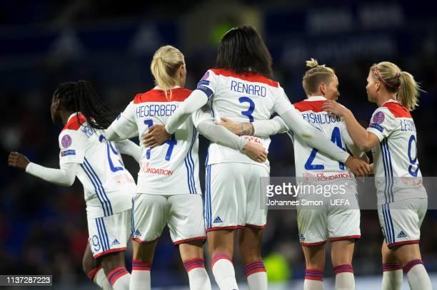 Wendie Renard celebrates with team mates Griedge M'Bock Bathy Ada Hegerberg Jessica Fishlock and Eugenie Le Sommer after scoring her team's 2nd goal...