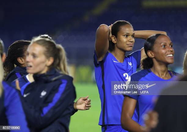 Wendie Renard of France blows out her cheeks as her and her team mates celebrate their result during the UEFA Women's Euro 2017 Group C match between...