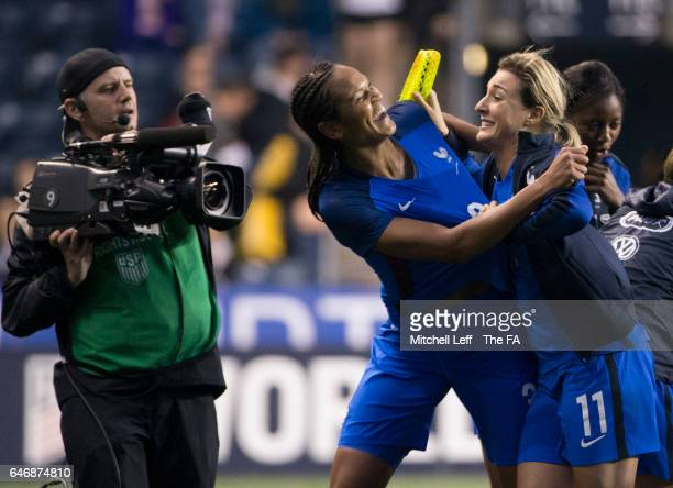 Wendie Renard of France celebrates with Claire Lavogez after scoring the game winning goal against the England during the SheBelieves Cup at Talen...