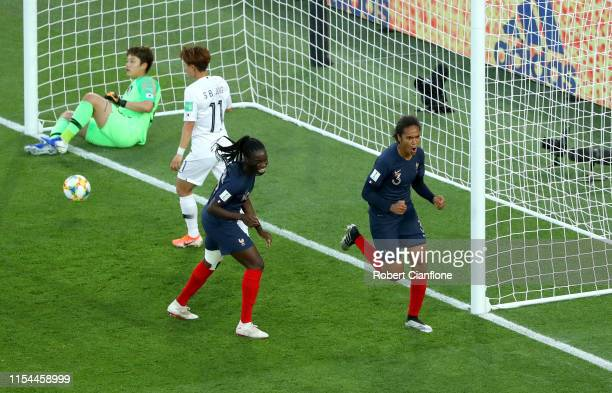 Wendie Renard of France celebrates with Griedge Mbock Bathy after scoring her team's second goal during the 2019 FIFA Women's World Cup France group...