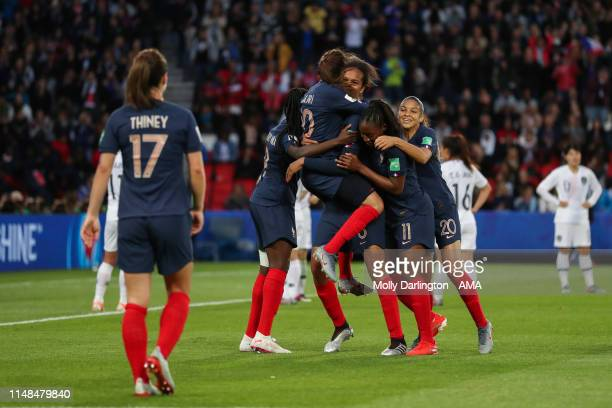 Wendie Renard of France celebrates with team mates after scoring a goal to make it 3-0 during the 2019 FIFA Women's World Cup France group A match...