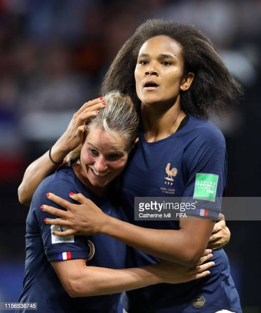 Wendie Renard of France celebrates with teammate Amandine Henry after scoring her team's first goal during the 2019 FIFA Women's World Cup France...