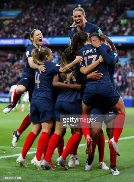 Wendie Renard of France celebrates with teammates after scoring her team's second goal during the 2019 FIFA Women's World Cup France group A match...