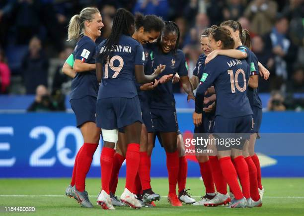Wendie Renard of France celebrates with teammates after scoring her team's third goal during the 2019 FIFA Women's World Cup France group A match...