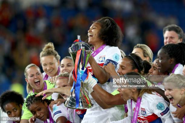 Wendie Renard of Lyon celebrates with the trophy after the final of the UEFA Women's Champions League Final between Lyon and Paris Saint Germain at...