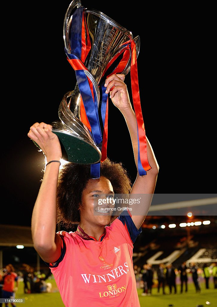 Wendie Renard of Lyon celebrates with the trophy after the UEFA Women's Champions League Final between Lyon and Turbine Potsdam at Craven Cottage on May 26, 2011 in London, England.