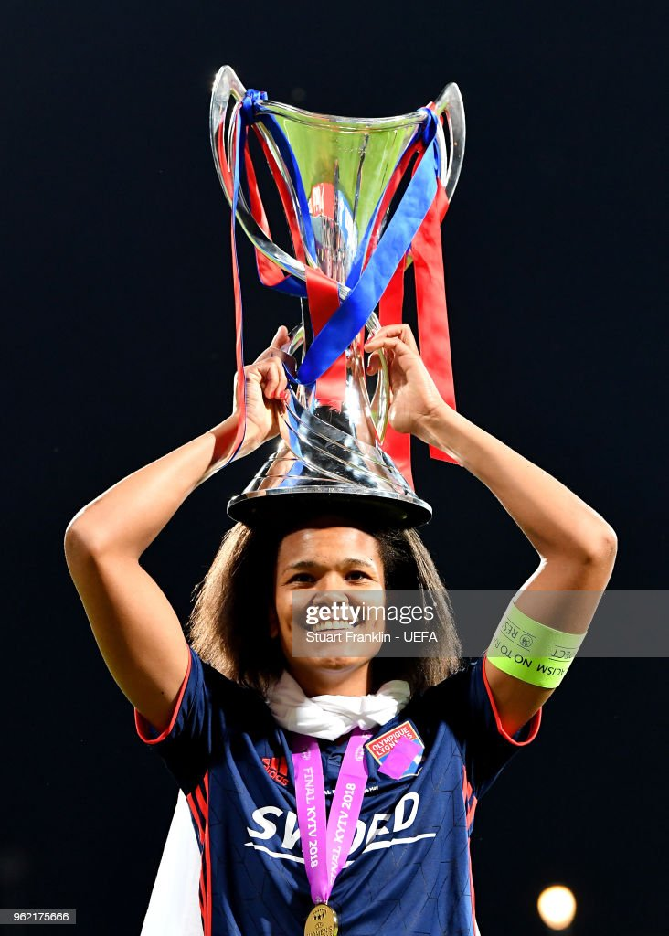 Wendie Renard of Lyon celebrates with the trophy after the UEFA Womens Champions League Final between VfL Wolfsburg and Olympique Lyonnais on May 24, 2018 in Kiev, Ukraine.