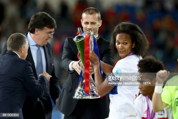 Wendie Renard of Lyon receives the trophy from UEFA president Aleksander Ceferin after the final of the UEFA Women's Champions League Final between...