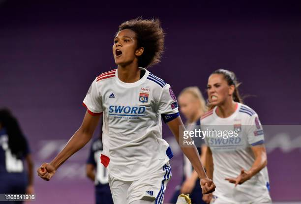 Wendie Renard of Olympique Lyonnais celebrates after scoring her team's first goal during the UEFA Women's Champions League Semi Final between Paris...