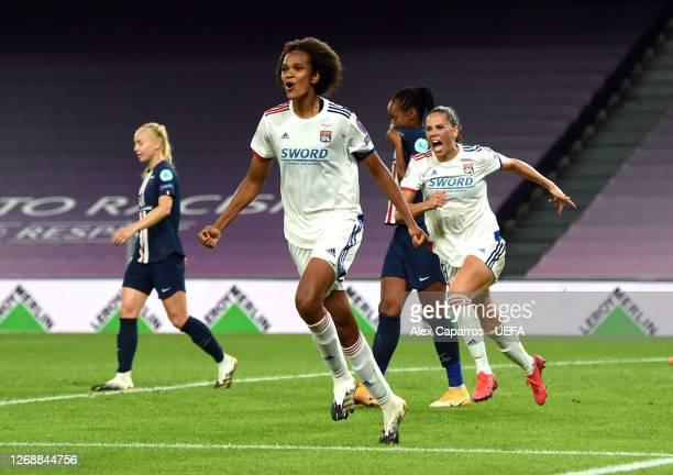 Wendie Renard of Olympique Lyonnais celebrates after scoring her team's first goal during the UEFA Women's Champions League Semi Final between Paris...