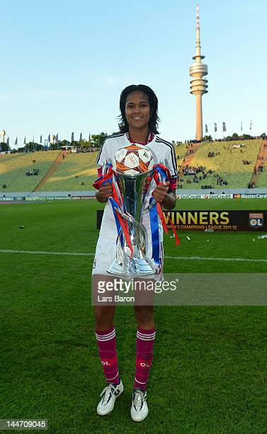 Wendie Renard of Olympique Lyonnais celebrates with the trophy after winning the UEFA Women's Champions League Final at Olympiastadion on May 17 2012...