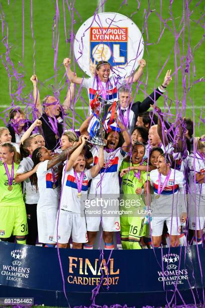 Wendie Renard of Olympique Lyonnais lifts the trophy with team mates in victory after the UEFA Women's Champions League Final between Lyon and Paris...