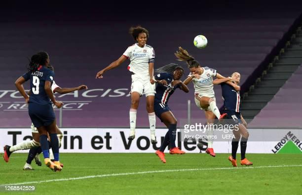 Wendie Renard of Olympique Lyonnais scores her team's third goal during the UEFA Women's Champions League Semi Final between Paris SaintGermain and...